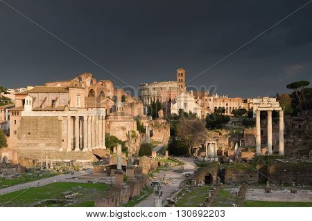 Dramatic sky over the Forum Romanum in the evening light Rome Italy