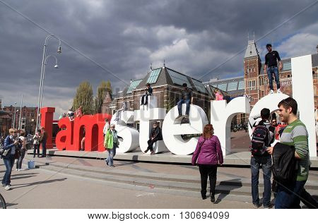 AMSTERDAM, NETHERLANDS - MAY 4, 2016: People in front of the Rijksmuseum and popular statue 'I Amsterdam' , Amsterdam, Netherlands.