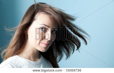 Pretty brunette wind portrait