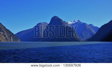 Morning scene in the Milford Sound New Zealand. Mt Pembroke. Mountains The Lion and The Elephant in the front.