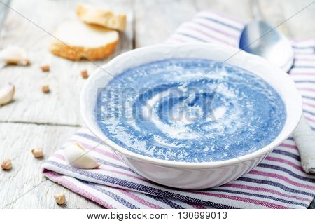 red cabbage chickpea soup puree on white wood background