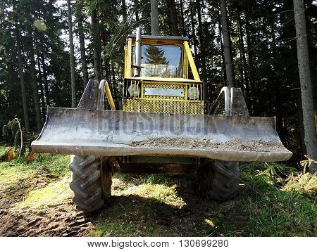 yellow special forestry tractors , Tractor in the woods