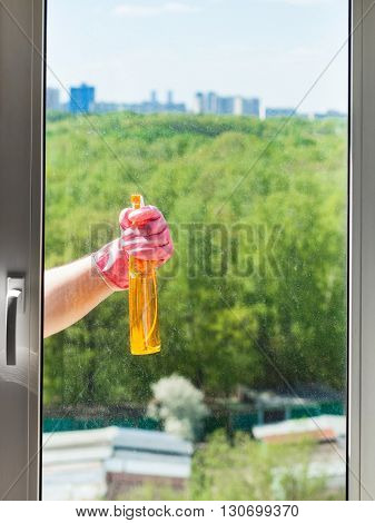 Cleaner Sprays Liquid From Spray Bottle To Window