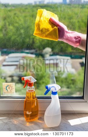 Cleaner Wipes Window Glass By Rag In Sunny Day