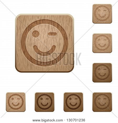Set of carved wooden winking emoticon buttons in 8 variations.