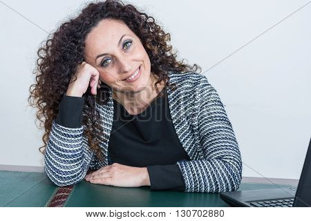 Portrait of mature woman. With curly hair blacks or dark green eyes on white or clear.