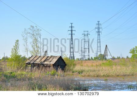 Power line in the countryside at spring on the outskirts of St. Petersburg Russia.
