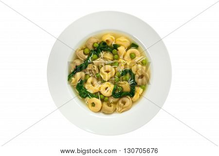 Spinach Tortellini Soup Isolated on white background. Selective focus.