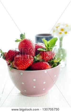 Bowl with strawberry still life backlight photography