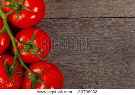 Red Tomatoes on the Vine. Selective focus.