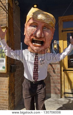 Asheville, North Carolina, USA - February 28, 2016: Humorous big mouthed presidential candidate Donald Trump character with pinsaying