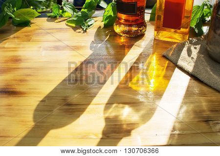 bottles of alcoholic drink glare on the table