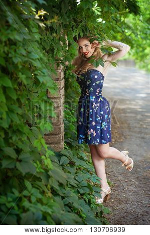Girl blonde in style Pin-up smiling outdoors