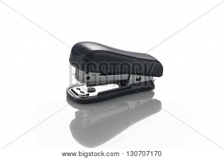 Stapler paper isolated on a white background with reflection