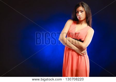 Mixed Race Girl In Party Dress On Blue