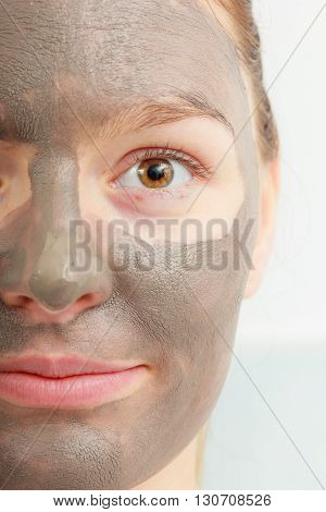 Closeup Female Face With Clay Mud Facial Mask