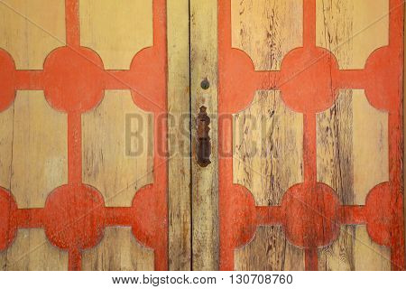 a picture of an exterior 19th century adobe wood door