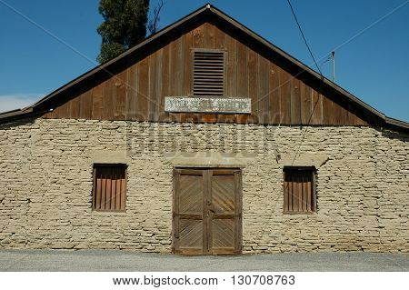 a picture of an exterior 19th century adobe barn house