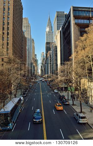 NYC streets. Midtown Manhattan - 42nd Street with Chrysler Building.
