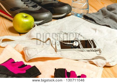 A set of sports equipment on the wooden floor. Close-up