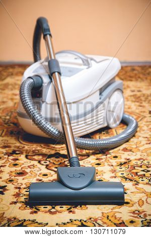 Vacuum cleaner on a Persian rug. top view