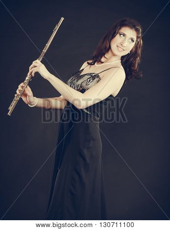 Elegant Woman With Flute Instrument.