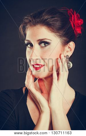 Beauty of women. Young attractive woman with strong dark make up. Portrait of elegant lady on black background.