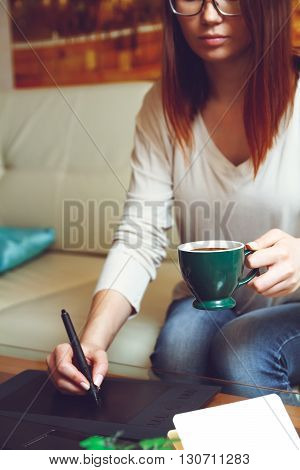 Designer at work with a cup of coffee. Telework concept
