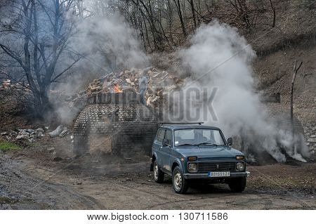 Klokocevac, Serbia - March 24 2016: The production of charcoal in a traditional manner in the forest using beech wood