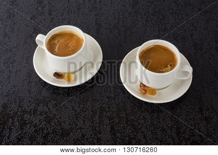 Strong coffee on black background. Coffee cup. Cup of coffee. Strong coffee. Morning coffee. Coffee break. Coffee mug. Strong coffee.
