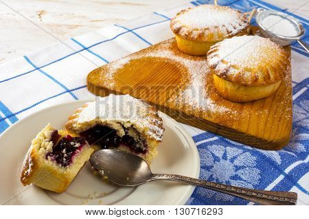 Sweet dessert on the white plate. Sweet dessert. Sweet pastry. Small pie. Pie. Jam pie