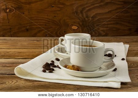 Coffee cups served on the linen napkin. Coffee cup. Strong coffee. Coffee mug. Morning coffee. Coffee break. Cup of coffee.