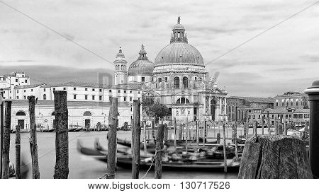 Beautiful view of traditional Gondolas on Canal Grande with historic Basilica di Santa Maria della Salute Venice Italy.