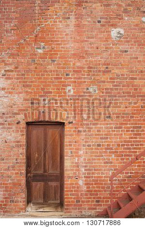 Timber Door In Red Brick Building