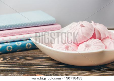 Fresh Pink Marshmallows - Zephyr in White Plate on Wooden Background. Sweet Dessert Concept