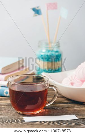 Fresh Pink Zephyr - Marshmallow and Cup of Tea on Brown Wooden Table. Sweet Dessert Concept