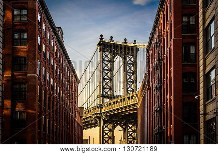View of Manhattan Bridge shot during sunset from a street in Brooklyn