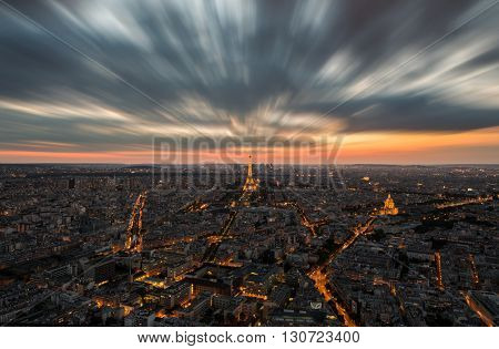Paris, France at sunset. Aerial view on the Eiffel Tower, Arc de Triomphe, Les Invalides etc.