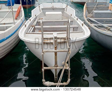 fishing boat full of water near a pier