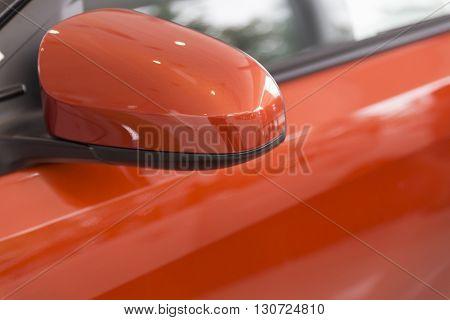 Rear Mirror Of Orange Car