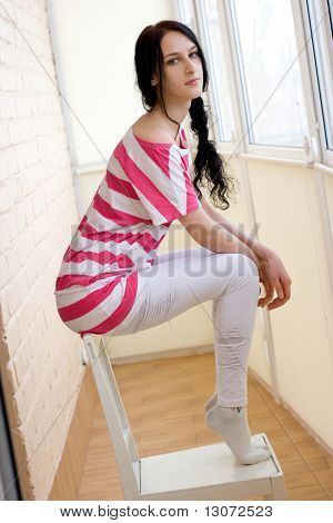 Caucasian Young Woman On The Chair