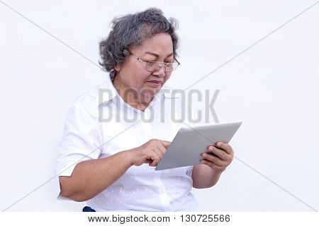Old Asian Grandmother Watch And Touch Tablet
