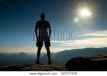 Alone Hiker In Black Pants  Stand On Rock Empire And Watching Over The Misty And Foggy Morning Valle