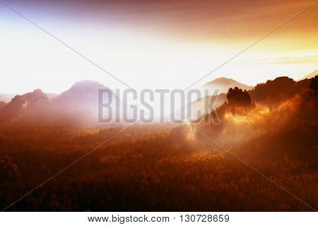 Red Filter Photo. Red Daybreak. Misty Daybreak In A Beautiful Hills. Peaks Of Hills Are Sticking Out