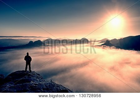 Man Stands On Peak Of Sandstone Rock In Saxony Switzerland Park And Watching To Sun. Beautiful Mirac