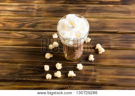 Caramel Popcorn Cacao with Whipped Cream. Unhealthy food