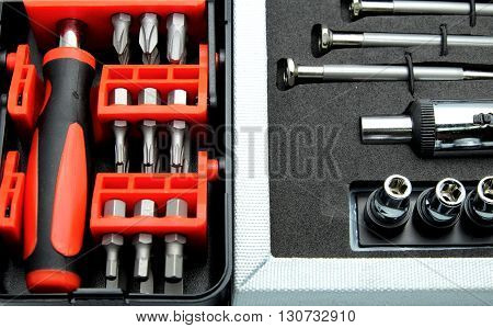 Close up of two sets of tool, screwdriver with adjustable torque in tool box.