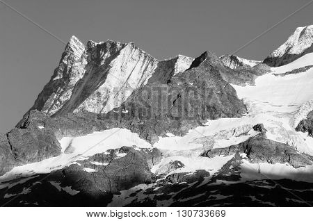 Bernese Alps, Switzerland - snow capped mountains and deep valleys stunning view breath-taking panorama