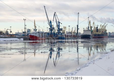 SAINT PETERSBURG, RUSSIA - FEBRUARY 17, 2016: Kanonersky Canal - the greater cargo port of St. Petersburg cloudy february morning. The largest port in the northern capital of Russia