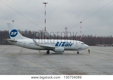 SAINT PETERSBURG, RUSSIA - DECEMBER 12, 2015: A Boeing 737-500 (VQ-BJQ) UTair airline on the tarmac at the airport Pulkovo